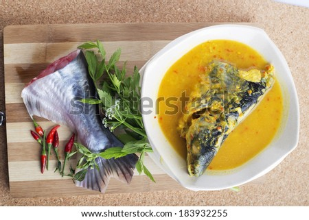 Patin silver catfish head with durian paste and chillies. Famous food in Malaysian traditional dishes. - stock photo