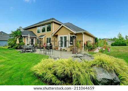Patio area on walkout backyard deck with beautiful landscape - stock photo