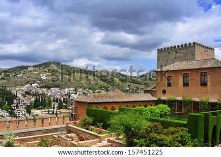Patio de Machuca in Nasrid Palaces in La Alhambra and Sacromonte in the background in Granada, Spain - stock photo