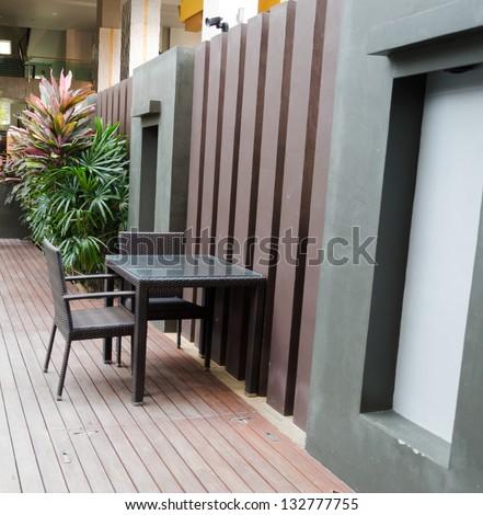 Patio furniture in a beautiful garden. - stock photo