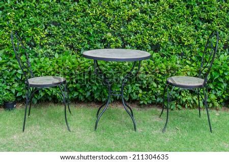 Patio furniture in the garden. - stock photo