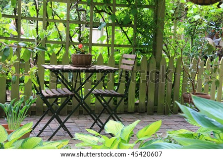Patio furniture on a cozy little terrace. - stock photo
