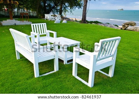 patio furniture on lawn next beach