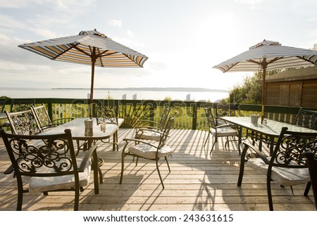Patio furniture on the deck with lake view, Nova Scotia - stock photo