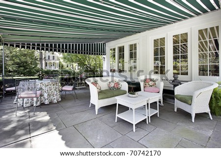 Patio in luxury home with green awning - stock photo