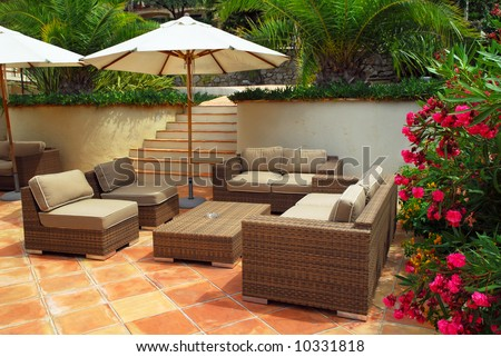 Patio of mediterranean villa in French Riviera with wicker furniture - stock photo
