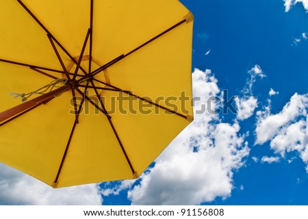Patio umbrella against sunny blue sky