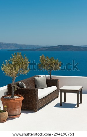 Patio with caldera view in traditional Santorini house, Greece - stock photo