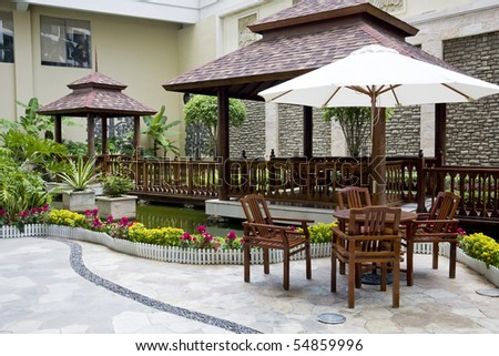 patio with table and chairs - stock photo