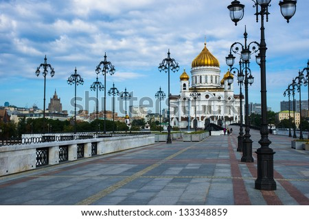 Patriarch bridge lamps and Cathedral of Christ the Savior in Moscow, Russia early in summer morning - stock photo
