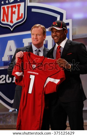 Patrick Peterson is introduced by Commissioner of the National Football League Roger Goodell as the fifth pick to the Arizona Cardinals at the NFL Draft 2011 at Radio City Music Hall in New York, NY. - stock photo