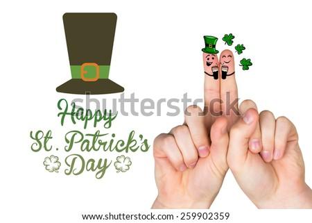 Patricks Day fingers against patricks day greeting - stock photo