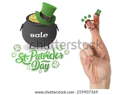 Patricks Day fingers against st patricks day sale ad - stock photo