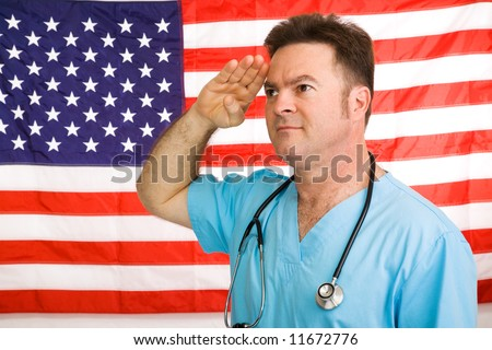 Patriotic American doctor giving a salute to the flag.  Photographed in front of flag, not a composite image. - stock photo