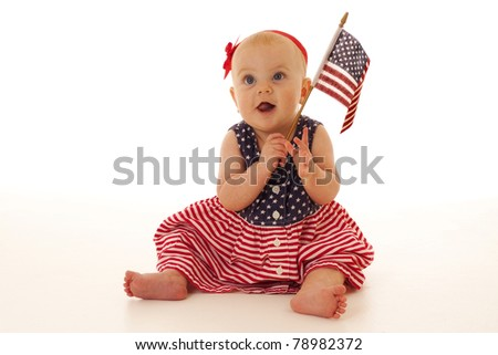 Patriotic baby girl holding a United States flag - stock photo