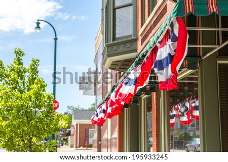 Patriotic  bunting on a business in a small town, shallow depth  - stock photo