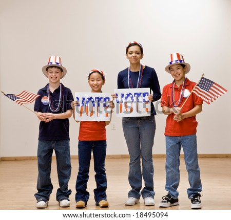 Patriotic children holding American flag and wearing hats with vote sign