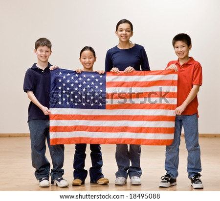 Patriotic children holding up the American flag together