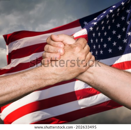 Patriotic concept. Handshaking. The USA flag and shaking hands of two male people