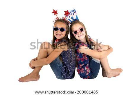 patriotic girls sitting missing front teeth smiling - stock photo