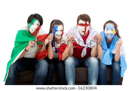 Patriotic group of people from different countries and flags painted on their faces watching television - stock photo