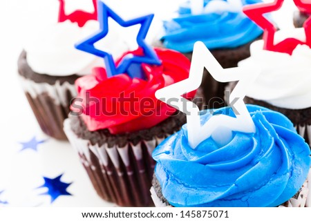 Patriotic holiday cupcakes decorated with stars. - stock photo