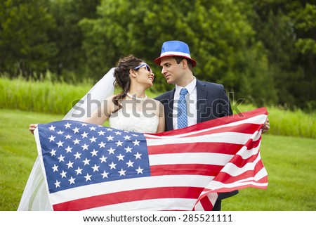 Patriotic holiday married couple with American flag for july 4th