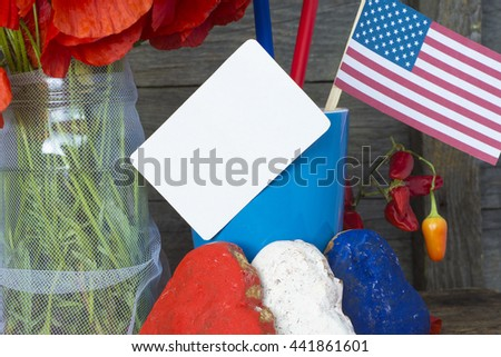 patriotic party. Heart shaped cookies color red, blue, white. cocktail with straws. USA flag and a bouquet of red poppies. note pad for text. celebrating July 4th, or Flag Day