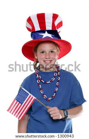 Patriotic young girl waving flag and wearing a patriotic hat isolated against a white background.