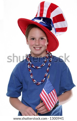 Patriotic young girl with American Flag isolated against a white background.