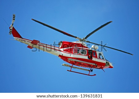 patrol helicopter of firefighters in blue sky over a fire 4 - stock photo