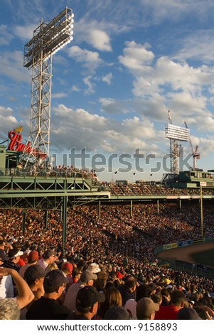 Patrons and fans take in a game at Fenway Park in summer - stock photo