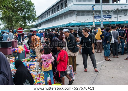 Pattani, Thailand 5 December 2016 : The people always buy some things, such as clothes, food, and bags, at street market in Pattani province.