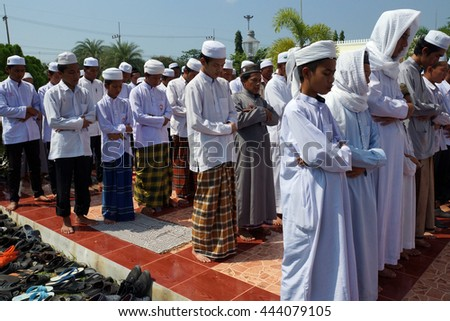 Pattani Thailand - June 18, 2014 : men praying in the historic pattani Masjid mosque