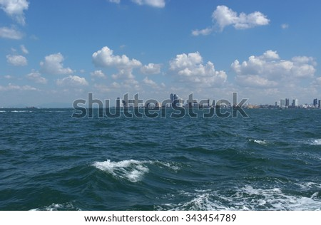 Pattaya city skyline with buildings and skyscrapers in day time, view from boat - stock photo
