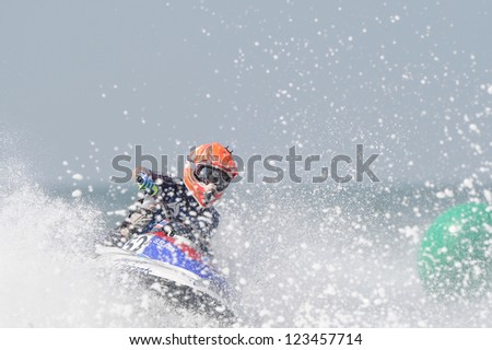 PATTAYA CITY THAILAND-DECEMBER 8:Supak Settura of Thailand in action during moto2 class Pro Sport GP the Jetski  King's Cup World Cup Grand Prix at Jomtien Beach on Dec8, 2012 in,Thailand.