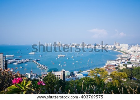 Pattaya Harbor and city view in the sunset.  - stock photo