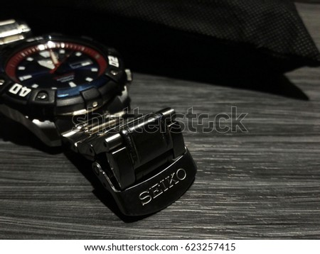 Pattaya Thailand - April 8 2017: SEIKO Classic watch Silver Aluminum Case with Black Sport displaying on dark wooden table.