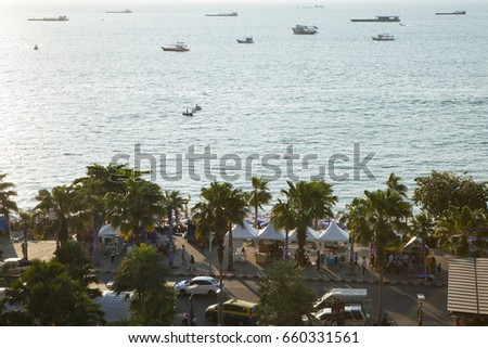 PATTAYA, THAILAND - APRIL 1,2014 : View of Pattaya beach road waterfront area and the entrance to Central shopping mall which is in the downtown area of the city on APRIL 1, 2014 in Pattaya