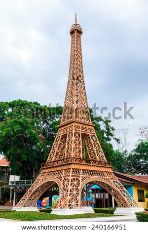 PATTAYA, THAILAND - DECEMBER 27, 2014: Eiffel tower replica in Mini Siam Park. Mini Siam is a famous miniature park attraction. It had been constructed in 1986