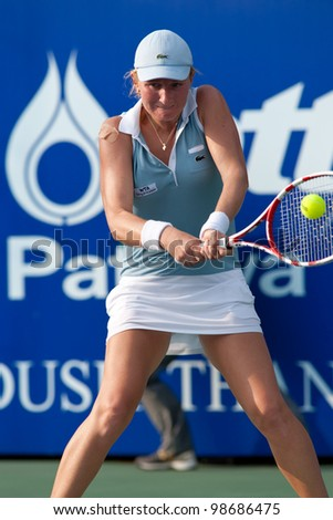 PATTAYA THAILAND - FEBRUARY 9: Alia Kudryavtseva of Russia returns a ball during Round 2 of PTT Pattaya Open 2012 on February 9, 2012 at Dusit Thani Hotel in Pattaya, Thailand - stock photo