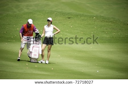 PATTAYA THAILAND - FEBRUARY 19: American golfer Michelle Wie waits for her turn during Day 3 of Honda LPGA Thailand 2011 on February 19, 2011 at Siam Country Club Old Course in Pattaya, Thailand