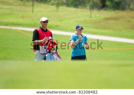 PATTAYA THAILAND - FEBRUARY 20: American player Stacy Lewis thinks of the next move during Day 4 of Honda LPGA Thailand on February 20, 2011 at Siam Country Club Old Course in Pattaya, Thailand