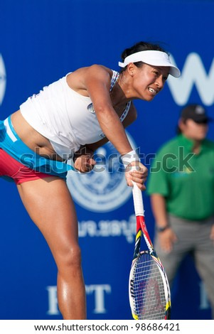 PATTAYA THAILAND - FEBRUARY 9: Anne Keothavong of Great Britain takes the 1st serve during Round 2 of PTT Pattaya Open 2012 on February 9, 2012 at Dusit Thani Hotel in Pattaya, Thailand - stock photo