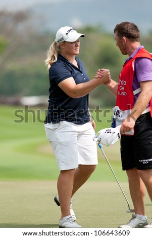 PATTAYA, THAILAND-FEBRUARY 16: Caroline Hedwall of Sweden shakes hands with caddy during Round 1 of Honda LPGA 2012 on February 16, 2012 at Siam Country Club Old Course in Pattaya, Thailand