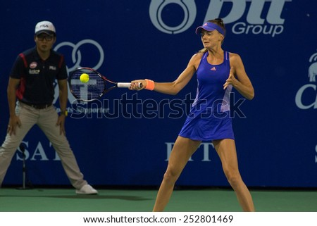 PATTAYA, THAILAND-FEBRUARY 10: Daniela Hantuchova of Slovakia returns the ball during Day 2 of 2015 PTT Thailand Open on February 10, 2015 in Pattaya, Thailand. - stock photo