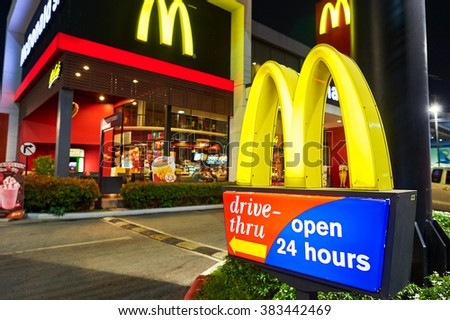 PATTAYA, THAILAND - FEBRUARY 21, 2016: McDonald's restaurant at night. McDonald's primarily sells hamburgers, cheeseburgers, chicken, french fries, breakfast items, soft drinks, milkshakes, desserts - stock photo