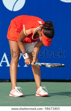 PATTAYA, THAILAND - FEBRUARY 9: Sania Mirza of India reacts after losing a point during Round 2 of PTT Pattaya Open 2012 on February 9, 2012 at Dusit Thani Hotel in Pattaya, Thailand - stock photo