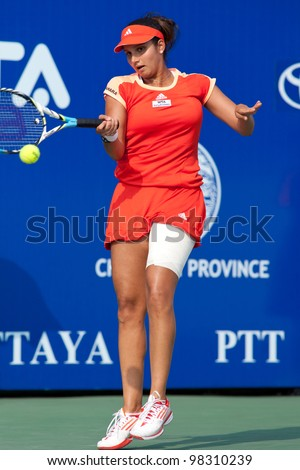 PATTAYA THAILAND - FEBRUARY 9: Sania Mirza of India returns a ball during Round 2 of PTT Pattaya Open 2012 on February 9, 2012 at Dusit Thani Hotel in Pattaya, Thailand - stock photo