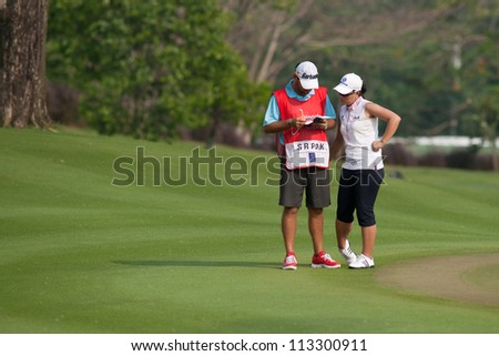 PATTAYA THAILAND - FEBRUARY 16: Se Ri Pak of Korea checks her score during Day 1 of Honda LPGA Thailand 2012 on February 16, 2012 at Siam Country Club Old Course in Pattaya, Thailand